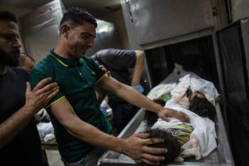 A relative mourns over the bodies of four young brothers from the Tanani family killed in an Israeli airstrike in Gaza, May 14, 2021. Khalil Hamra   AP