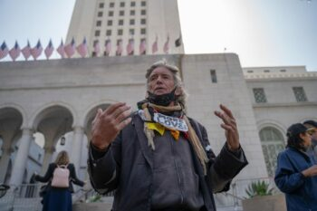 A displaced park resident named David speaks at a press conference in front of City Hall. Photo credit: Jeremy Lindenfeld / WhoWhatWhy
