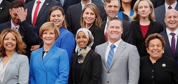Democratic Representative-elect Ilhan Omar (C) of Minnesota, one of the first Muslim women elected to Congress, poses in the front row with other incoming newly elected members of the U.S. House of Representatives on Capitol Hill in Washington, U.S., November 14, 2018. REUTERS/Kevin Lamarque - RC199D14A510