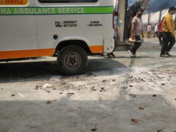 An ambulance has run over a pile of ashes at Nigambodh crematorium, caused by lack of space. Photo: Naomi Barton/The Wire