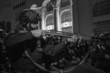 | Officer Andrey Nichik points his gun at protesters and journalists while yelling at them to clear the area Photo credit Jeremy Lindenfeld WhoWhatWhy | MR Online