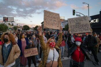 Protesters block traffic on Lemoyne Street. Photo credit: Jeremy Lindenfeld / WhoWhatWhy