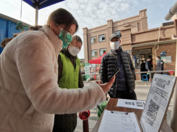 Community Workers in China Helping with Household Information Registration