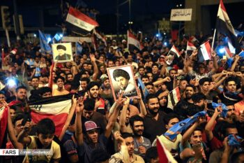 Supporters of Muqtada As-Sadr's alliance in Liberation Square, Baghdad celebrating a successful election campaign, May 2018. (Fars News Agency, CC BY 4.0, Wikimedia Commons)