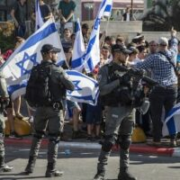 ISRAELI PARAMILITARY BORDER POLICE OFFICERS STAND GUARD AS JEWISH RIGHT-WING DEMONSTRATORS DEMAND THE RELEASE OF THREE JEWS ARRESTED IN THE SHOOTING DEATH OF MOUSA HASOONA, OUTSIDE THE DISTRICT COURT IN LOD, ISRAEL, WEDNESDAY, MAY 12, 2021. (AP PHOTO/HEIDI LEVINE)
