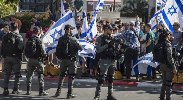 | ISRAELI PARAMILITARY BORDER POLICE OFFICERS STAND GUARD AS JEWISH RIGHTWING DEMONSTRATORS DEMAND THE RELEASE OF THREE JEWS ARRESTED IN THE SHOOTING DEATH OF MOUSA HASOONA OUTSIDE THE DISTRICT COURT IN LOD ISRAEL WEDNESDAY MAY 12 2021 AP PHOTOHEIDI LEVINE | MR Online