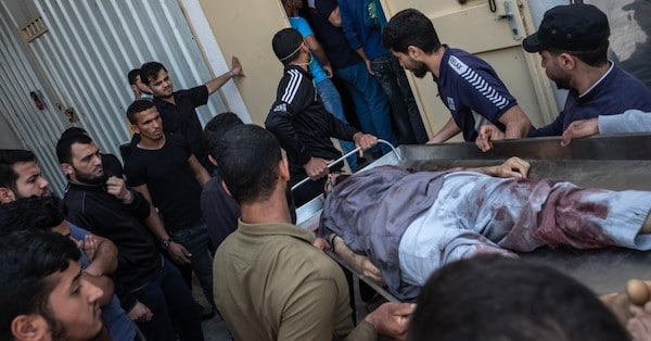 The body of a Palestinian man named Ahmed Al-Shenbari, who was killed during an Israeli raid on Beit Hanoun City, is taken to a mortuary on May 11, 2021 in Gaza. (Photo: Fatima Shbair via Getty Images)