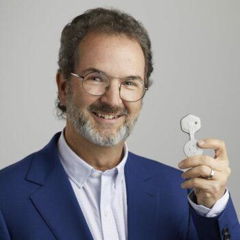 | BioIntelliSense CEO James Mault poses with the companys BioSticker wearable Source httpsbiointellisensecom | MR Online