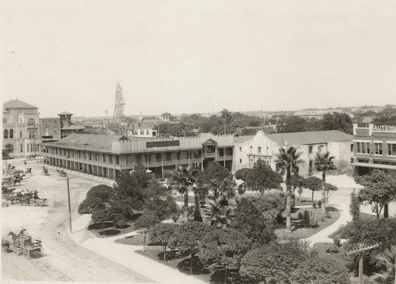 A photograph of Alamo Plaza from approximately 1910, showing the Hugo & Schmeltzer building attached to the Alamo church. ADINA EMILIA DE ZAVALA PAPERS, DI_10567, THE DOLPH BRISCOE CENTER FOR AMERICAN HISTORY, THE UNIVERSITY OF TEXAS AT AUSTIN