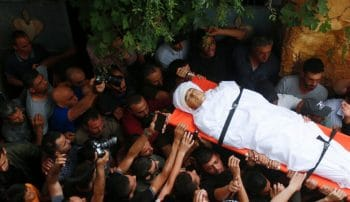 | MOURNERS CARRY THE BODY OF PALESTINIAN TEENAGER AHMED ZAHI BANI SHAMSA WHO DIED OF WOUNDS SUSTAINED AT THE HANDS OF ISRAELI FORCES DURING CLASHES IN THE VILLAGE OF BEITA SOUTH OF IN THE WEST BANK OF NABLUS ON JUNE 17 2021 PHOTO BY SHADI JARARAH C APA IMAGES | MR Online