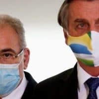 Brazil's health minister Marcelo Queiroga and Brazil's President Jair Bolsonaro. Photo: Reuters/Ueslei Marcelino/File Photo