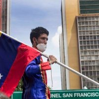 Protester at a rally calling for jailed workers to be released, in Caracas on June 22. Photo: Surgentes/FB