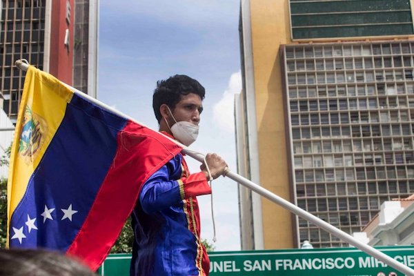 | Protester at a rally calling for jailed workers to be released in Caracas on June 22 Photo SurgentesFB | MR Online