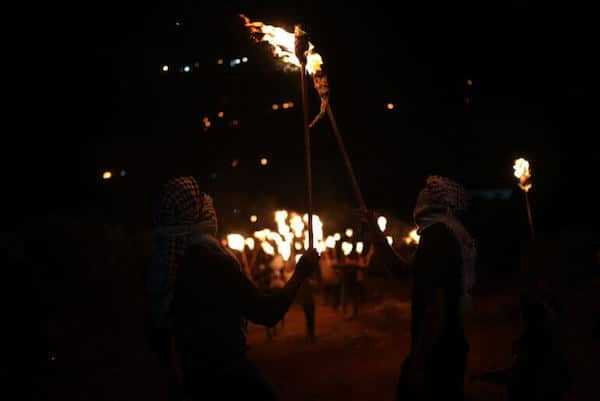 | PALESTINIANS CARRY TORCHES DURING A NIGHT DEMONSTRATION AGAINST THE EXPANSION OF A JEWISH SETTLEMENT ON THE LANDS OF BEITA VILLAGE NEAR THE OCCUPIED WEST BANK CITY OF NABLUS ON JUNE 23 2021 PHOTO BY SHADI JARARAH C APA IMAGES | MR Online