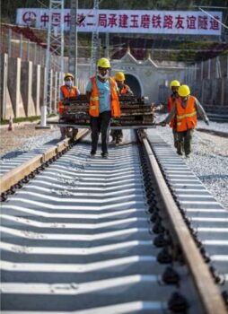 Workers carry out construction of the Sino-Laos railway. [Source: Kunming.cn]