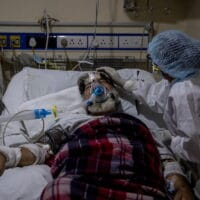 A medical worker tends to a patient suffering from the coronavirus disease (COVID-19), inside the ICU ward at a hospital in New Delhi, India, April 29, 2021