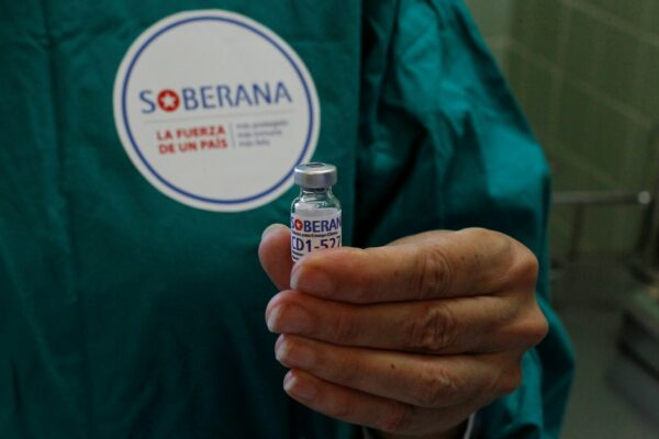 A nurse shows a dose of the Soberana-02 COVID-19 vaccine to be used in a volunteer as part of Phase III trials of the experimental Cuban vaccine candidate in Havana, Cuba, March 31, 2021