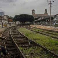 A worker takes a breaks on the tracks of the Central Railway Station, in Havana, Cuba