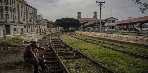 | A worker takes a breaks on the tracks of the Central Railway Station in Havana Cuba | MR Online