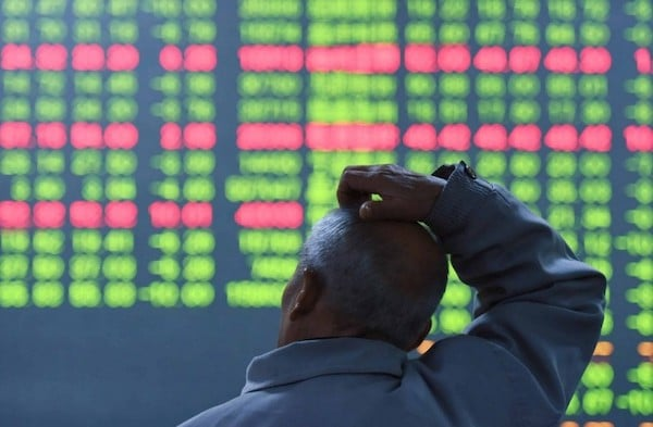 | An investor looks on as prices fall at a stock brokerage house in Hangzhou China Photo Canadian Dimension Shutterstock | MR Online