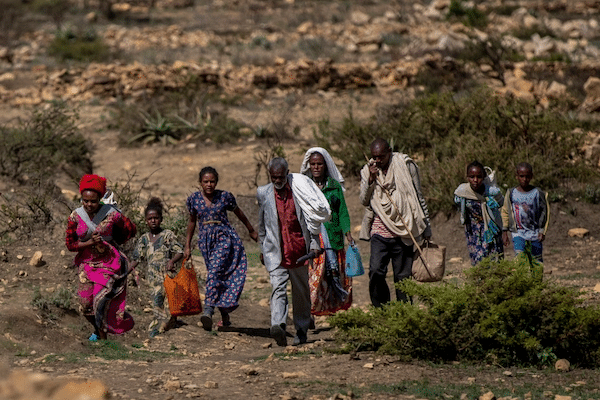 | People walk from a rural area towards the town of Agula in the Tigray region of northern Ethiopia where the Relief Society of Tigray was distributing food Ben CurtisAP | MR Online