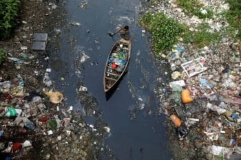 | A boy collects plastic from a stream in Dhaka Bangladesh | MR Online
