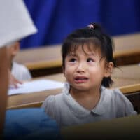 A child student cries at a tutoring school in Hefei, Anhui province, 2018