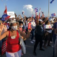 Cubans take part in a mass rally in defence of the Cuban Revolution and calling for an end to U.S. sanctions, July 2021.