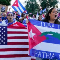 Floridians from Cuba's ex-pat community in Hialeah, Fla. protest