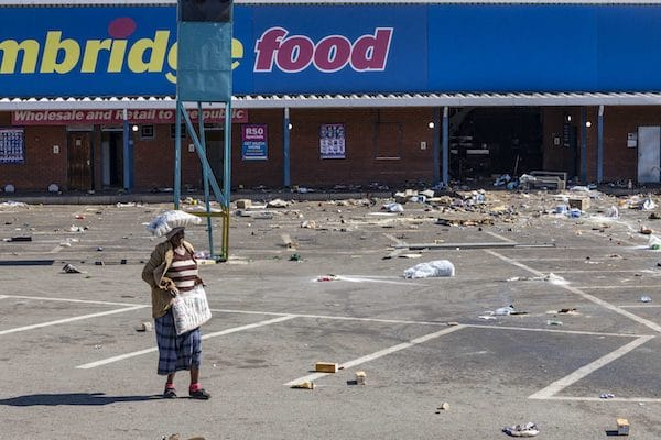 | Woman carries looted goods Gold Spot Shopping Centre Vosloorus | MR Online