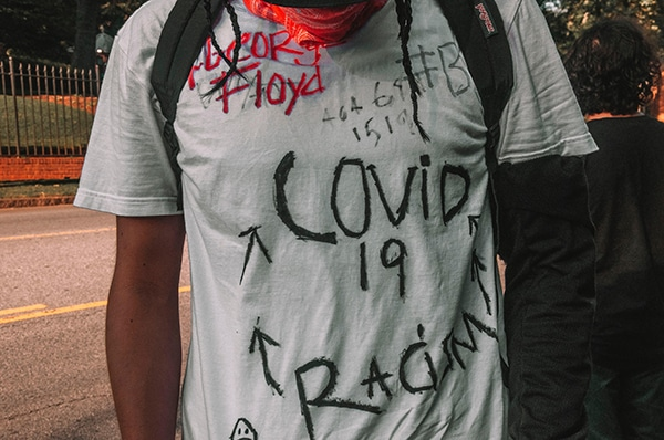 | Man in shirt with covid19 George Floyd racism writing | MR Online