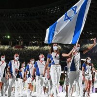 FLAG BEARERS HANNA MINENKO AND YAKOV TOUMARKIN OF TEAM ISRAEL DURING THE OPENING CEREMONY OF THE TOKYO 2020 OLYMPIC GAMES, JULY 23, 2021