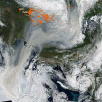Satellite image showing smoke from Siberian forest fires reaching the North Pole August 3, 2021