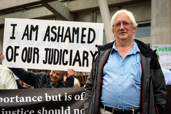 | Craig Murray poses with supporters outside the Scottish Parliament Photo The Scotsman | MR Online
