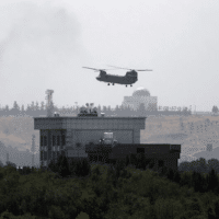 The New York Times (8/15/21) ran the next best thing to a photo of a helicopter taking off from the Kabul embassy roof: a photo of a helicopter flying over the embassy roof.