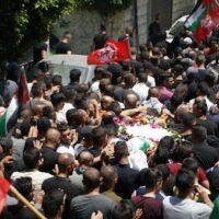 MOURNERS IN BEIT UMMAR CARRY THE BODY OF 11-YEAR-OLD MOHAMMED AL-ALAMI WHO WAS KILLED BY ISRAELI SOLDERIS WHILE ON HIS WAY HOME FROM GROCERY SHOPPING WITH HIS FAMILY . JULY 29TH, 2021