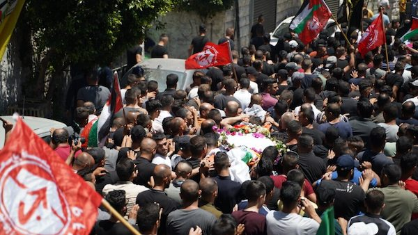 | MOURNERS IN BEIT UMMAR CARRY THE BODY OF 11YEAROLD MOHAMMED ALALAMI WHO WAS KILLED BY ISRAELI SOLDERIS WHILE ON HIS WAY HOME FROM GROCERY SHOPPING WITH HIS FAMILY JULY 29TH 2021 | MR Online