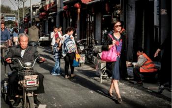 | Chao Xiaomi walks down a street in Beijing | MR Online