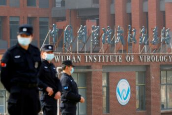   Security personnel keep watch outside the Wuhan Institute of Virology   MR Online
