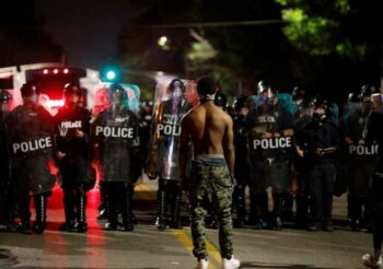 | Demonstrator protesting police brutality following the killing of Michael Brown in Ferguson Missouri in 2014 | MR Online
