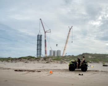   TWO BEACHGOERS RIDE PAST THE SPACEX LAUNCH FACILITY AT BOCA CHICA BEACH PHOTO IVAN   MR Online