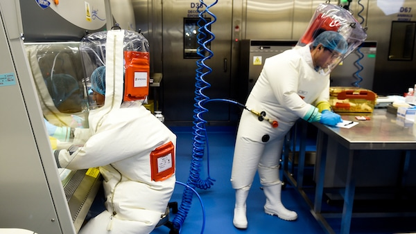 | Researchers work in a lab of the Wuhan Institute of Virology in Wuhan in central Chinas Hubei province Feb 23 2017 | MR Online