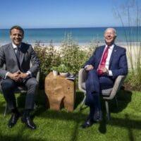 French President Emmanuel Macron (L) and US President Joe Biden enjoy a light moment at the G7, Cornwall, UK, June 12, 2021