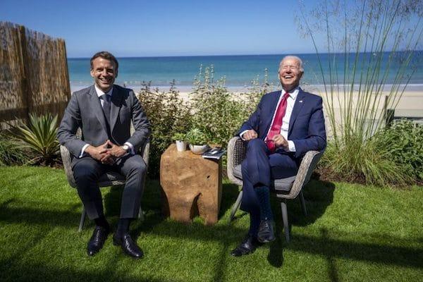 | French President Emmanuel Macron L and US President Joe Biden enjoy a light moment at the G7 Cornwall UK June 12 2021 | MR Online