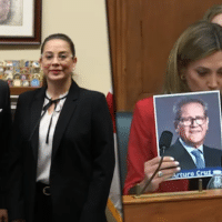 Far-right Florida Congresswoman María Elvira Salazar holding up photos of US-funded coup leaders Felix Maradiaga and Arturo Cruz at a hearing on Nicaragua