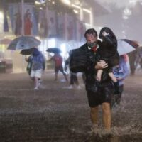 People walk through flooded streets in New York as the remnants of Hurricane Ida hit the city on the night of 1 September