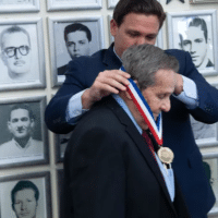Florida Governor Ron DeSantis pinning medal on CIA assassin Félix Rodríguez on September 16, 2021. [Source: flgov.com]