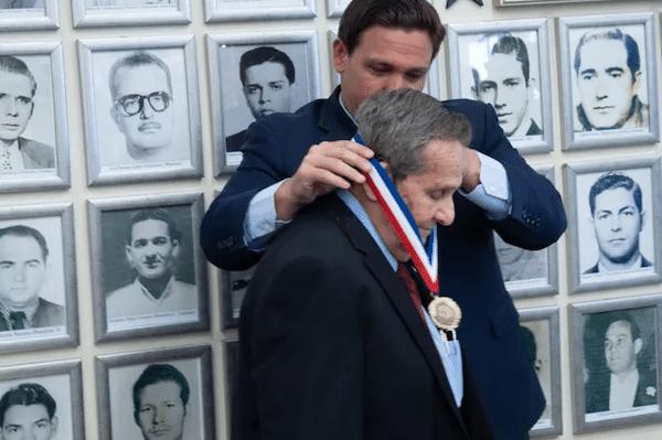 | Florida Governor Ron DeSantis pinning medal on CIA assassin Félix Rodríguez on September 16 2021 Source flgovcom | MR Online