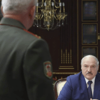 Belarusian President Alexander Lukashenko, right, pauses during a meeting with high level military officials in Minsk, Belarus, Aug. 5, 2021.