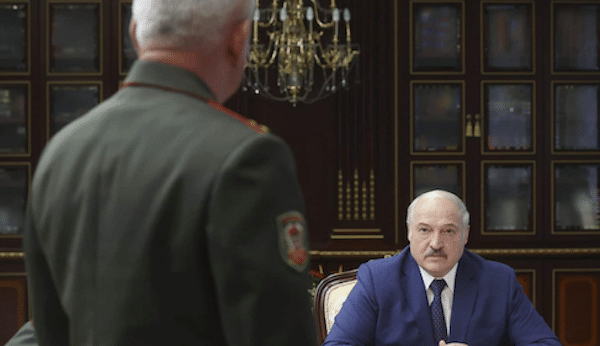 MR Online | Belarusian President Alexander Lukashenko right pauses during a meeting with high level military officials in Minsk Belarus Aug 5 2021 | MR Online